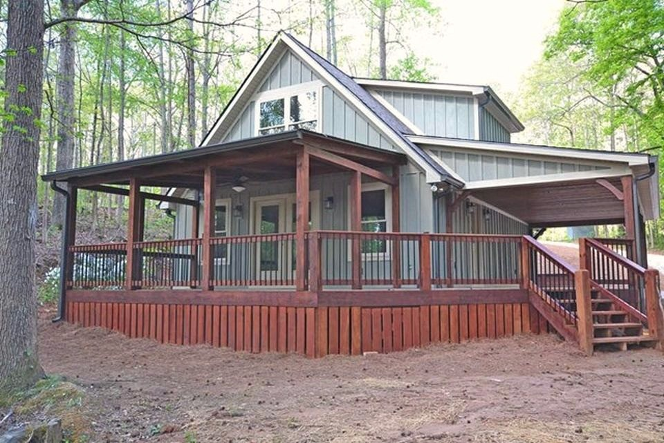 large home with beautiful wooden deck
